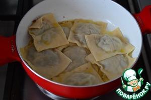 Boiled ravioli in warm fragrant oil.