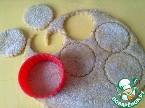 Sprinkle sugar on top and press it lightly with a rolling pin. Cut shapes of dough.