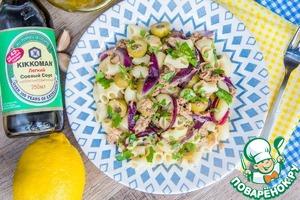 Разложить по тарелкам, украсить рубленной петрушкой и подать с лимоном.
