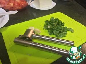 Finely chop the cilantro and prepare the garlic.
