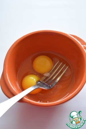 Egg whisk with a fork with a pinch of salt