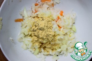 In cabbage-onion mixture, add mustard powder and cumin. Stir.