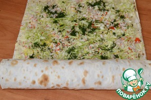 Tightly roll the lavash with filling into a log, wrap in plastic wrap and refrigerate for a few hours.  Bon appetit!