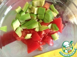 Tomato cut into medium dice avocado peel and cut into smaller cube than tomato.