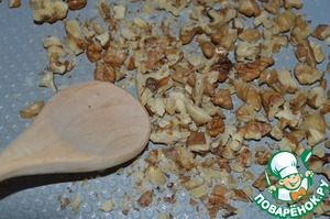 While cooking the rice, chop the nuts and fry them on a dry pan until Golden brown.