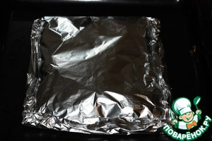 Close the chicken with foil, forming an envelope. Bake at 180 degrees for 20-25 minutes.