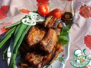 Ready ribs spread on a dish. Garnishes herbs and vegetables.   Bon appetit!