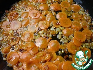 To the onions add the sliced carrots and cook the vegetables for 2-3 minutes.