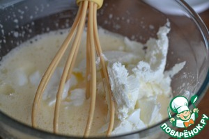 In a bowl, whisk the eggs with the sugar.  Add sour cream, cottage cheese and pudding. Mix well.