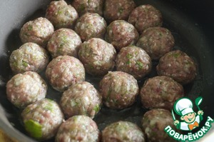In a pan heat vegetable oil and fry meatballs on both sides until light Golden brown.