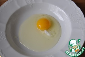 In a deep small bowl, beat egg with salt.