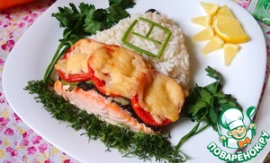Sell salmon with spicy garlic-olive sauce, tomatoes and cheese with rice and lemon wedges.