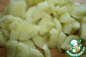 Cucumber also cut into quarters.