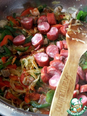 Add the chopped sausage and sprinkle all with paprika. Fry, stirring, until Browning.