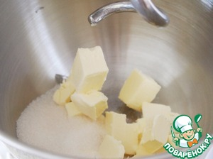To softened butter add sugar. Beat with a mixer.