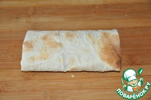 The edges of the lavash are folded up and turn into the envelope.