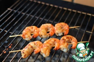 Fry the shrimp for literally half a minute on each side on the grill over the coals (if your shrimp were originally raw, you may need a little more time to fry up their redness);