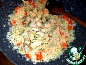Boiled until half-cooked Turkey breast  cut cubes and added to the rice.