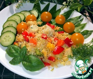 In a dish with rice, sliced cucumbers and added  cherry tomatoes.