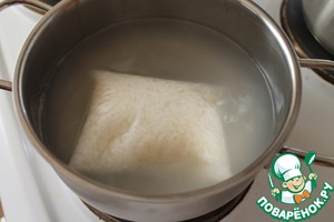 Drop the bag of rice in boiling water. Cook for 25 minutes.