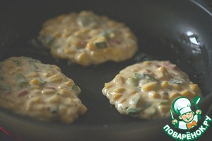 Heat the oil in a large frying pan and spread a tablespoon of the dough.