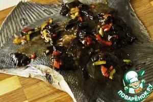 As the skin of the flounder is quite dense, it is necessary to make small incisions and thickly smear the fish with marinade, taking care that it penetrated the cuts.