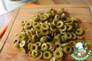 With olives drain off the brine, cut them in rings.