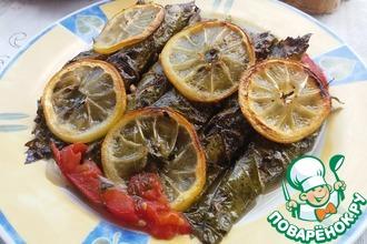 Рецепт: Сардины, запеченные в виноградных листьях