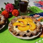 Ореховые корзиночки с пудингом и персиками