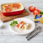 Рыба, запеченная с помидорами в сырном соусе