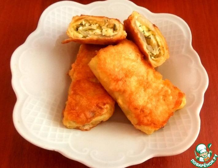 Рецепт: Капустные рулетики с яйцом и сыром