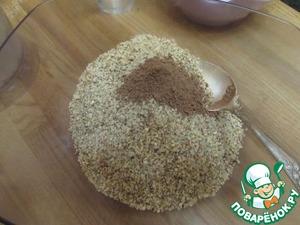 В отдельной посуде смешать крошку печенья и орехов, добавить какао-порошок, лимонный сок и все перемешать.