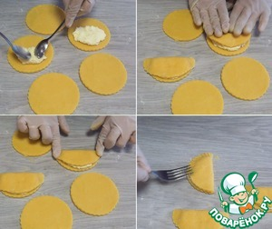 On half of each circle, spread 1 heaping tablespoon filling, cover the second half and lightly press down (press down well on the sides). You can seal the edges of the sochniki with a fork, so they better keep their shape when baking.