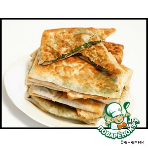 Hot appetizer of pita bread with cheese