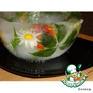 Ice bowl with fresh flowers