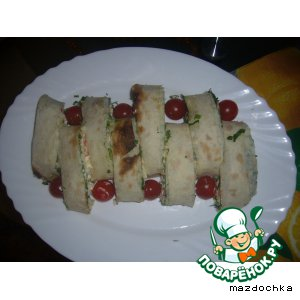 Roll of pita bread with crab sticks