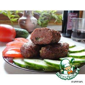 Sausages with cheese and herbs on the grill