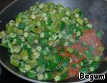 Add the tomato, stir and put in the wok okra.