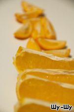 One orange and kumquats cut into 4 slices each.