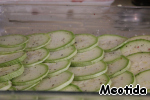 Spread a layer of chopped slices of zucchini,