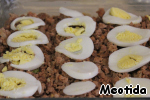 Slices of boiled eggs,