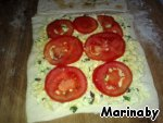 Cut thin slices of tomato on top and cover the filling