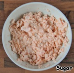 Fresh salmon boiled or steamed, either in the microwave or just in the water. Let cool and mash with a fork.