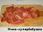 Chorizo cut into small slices. Bacon with layers of meat cut into pieces. Simple bacon cut into very, very small.