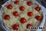 Put the halves of cherry tomatoes on top of cheese. Bake in a preheated 180 degree oven.
