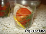 Tomatoes cut in half, put into molds (plastic cups), add slices of lemon and Apple, semicircles onions, greens...