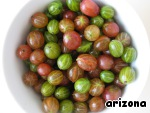 Gooseberries to sort, wash, dry, cut with scissors the stem and flowers.