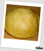 The dough removed from the refrigerator and divided into two parts. One part bigger than the other.