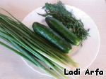To prepare this refreshing and quick to prepare soup take a bunch of green onions, a couple of fresh cucumbers and dill.