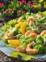 The lettuce and the oranges add the cucumber and shrimp.  Refreshed by a few drops of salad oil on top.  Priatnaia appétit! :)